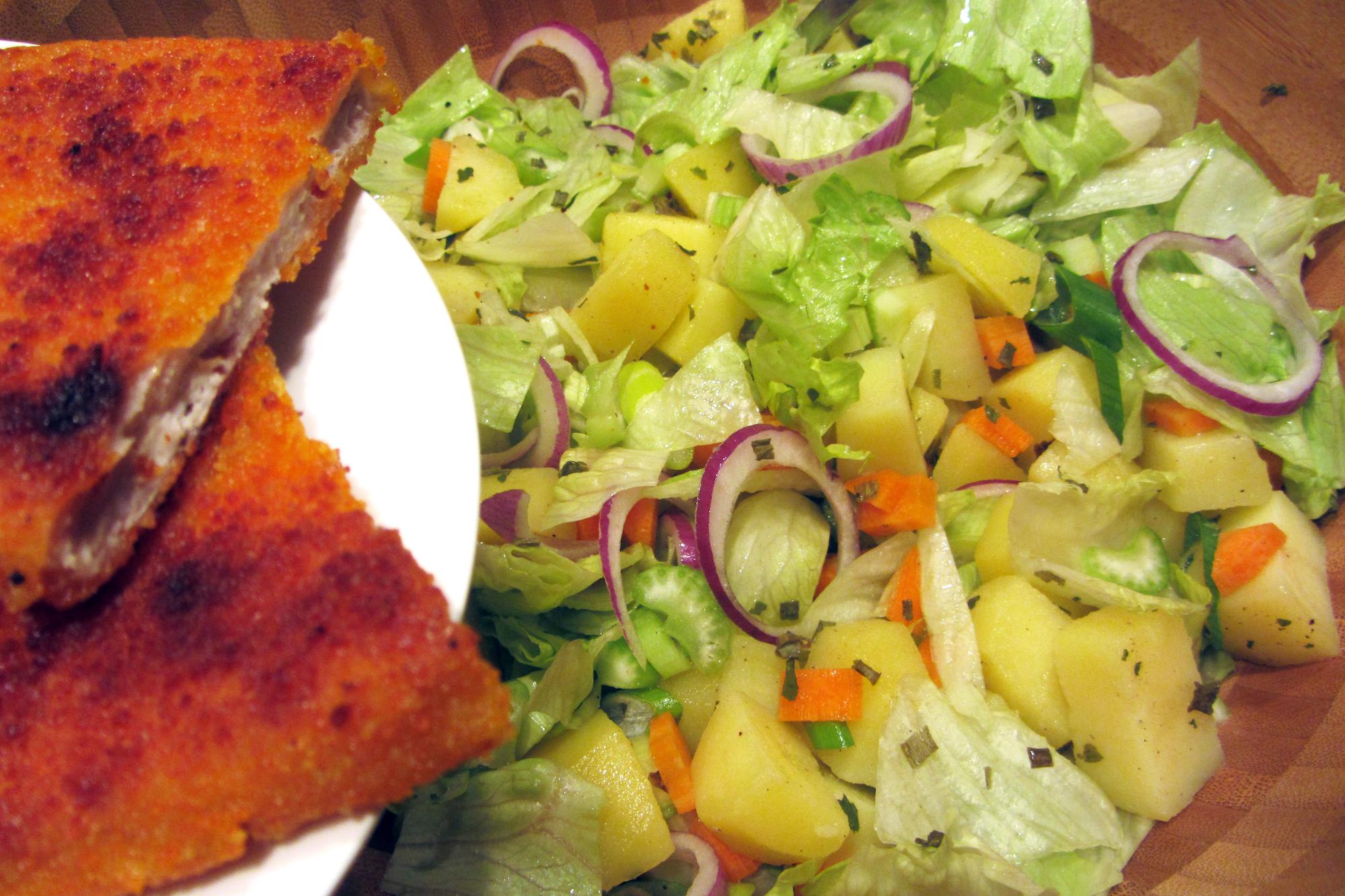 Krokante salade met kalkoenschnitzel